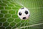 football-in-the-goal-net-100152347
